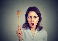 Shocked woman with cooking spoon royalty free stock photo