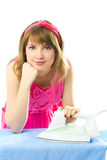 Young housewife with iron. Beautiful young housewife with iron against white background Royalty Free Stock Photography