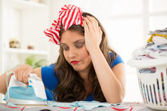 Young Housewife With Iron Royalty Free Stock Photography