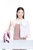 Young housewife ironing Royalty Free Stock Image