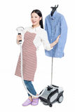 Young housewife ironing Stock Images