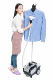Young housewife ironing Royalty Free Stock Photography