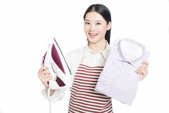 Young housewife ironing Royalty Free Stock Photos