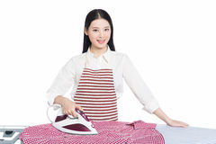 Young housewife ironing Royalty Free Stock Images