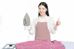 Young housewife ironing Stock Photography