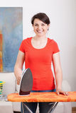 Young housewife during ironing Stock Photo