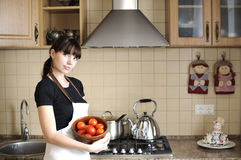 Young housewife in kitchen Stock Image
