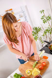 Young Housewife In The Kitchen Stock Photo