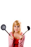 Young housewife with kitchen utensil Stock Photo
