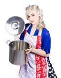 Young housewife lifting lid on a home cooking pot Stock Photo