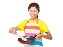 Young Housewife making for food Royalty Free Stock Images