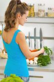 Young housewife making fresh vegetable salad Royalty Free Stock Photo