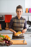 Young housewife peeling corn Royalty Free Stock Photography