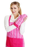 Young housewife in pink apron Stock Image