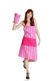 Young housewife in pink apron Stock Images