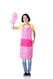 Young housewife in pink apron Stock Photos