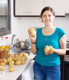 Young housewife with potatoes Stock Photo