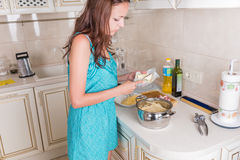 Young housewife preparing the dinner Royalty Free Stock Photography