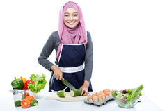 Young housewife preparing making food for dinner Royalty Free Stock Images