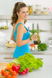 Young housewife preparing vegetables in kitchen Stock Image