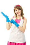Young housewife putting on rubber gloves Stock Photo