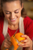 Young housewife removing orange peel Royalty Free Stock Photos