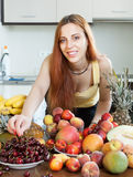 Young housewife with ripe fruits Stock Image