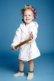 Young housewife with rolling pin Royalty Free Stock Image