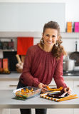 Young housewife serving baked pumpkin Stock Image