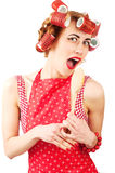 Young housewife singing with spoon Royalty Free Stock Photography