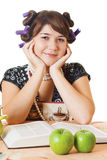 Young housewife sitting be the table. Young pretty housewife sitting at the table Stock Photos