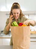 Young housewife sort purchases after shopping Royalty Free Stock Photos