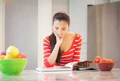 Young housewife thinking of a recipe for dinner Stock Image