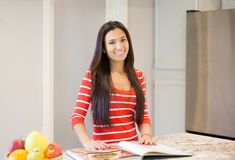 Young housewife thinking of a recipe for dinner Royalty Free Stock Photography