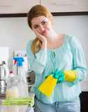 Young housewife tired dusting in domestic kitchen Stock Photography