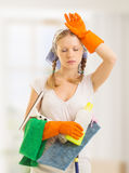 Young housewife is tired of housework Royalty Free Stock Images
