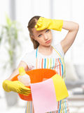 Young housewife is tired of housework Royalty Free Stock Image