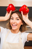 Young housewife tricky in the kitchen with paprica Royalty Free Stock Photo