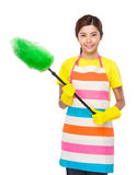 Young Housewife using duster with plastic gloves. Isolated on white background Stock Photos