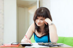 Young housewife with utility bills Royalty Free Stock Photo