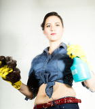 Young housewife washed window with a spray, cloth and detergent. Large glass in foam. Housework concept. Royalty Free Stock Photo