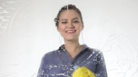 Young housewife washed window with a spray, cloth and detergent. Large glass in foam. Housework concept. stock footage