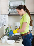 Young housewife washing dishes Royalty Free Stock Photography