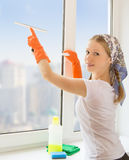 Young housewife washing the window Stock Photo