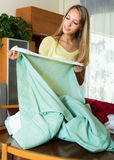 Young housewifel with new blinds Royalty Free Stock Image