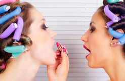 Young housewives beautifying themselves Stock Images