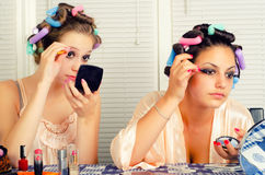 Young housewives having fun with cosmetics Royalty Free Stock Photo