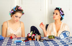 Young housewives having fun with cosmetics Royalty Free Stock Photos