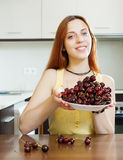 Young houswife holding cherry Stock Images