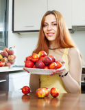 Young houswife holding nectarines Royalty Free Stock Photo